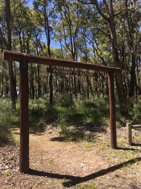 wooden entrance to bushland