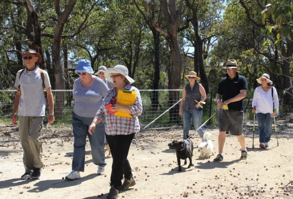 people walking in Brickwood that has just been given funds from the Peel Harvey Catchment Council Community Grants to help protect and enhance.