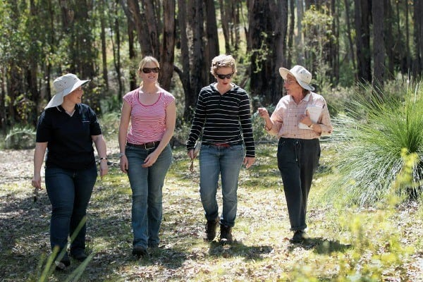 four women walking through a paddock in Jarrahdale for the Healthy Habitats- In the (conservation) zone for rate relief