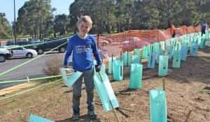 Child helps to plant at the National Tree Day Celebration