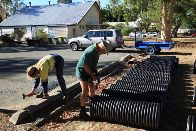 men constructing artificial nest boxes for Black Cockatoos at Landcare SJ , Mundijong Western Australi