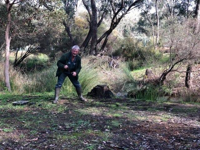 man planting at Gooralong Brook, Jarrahdale