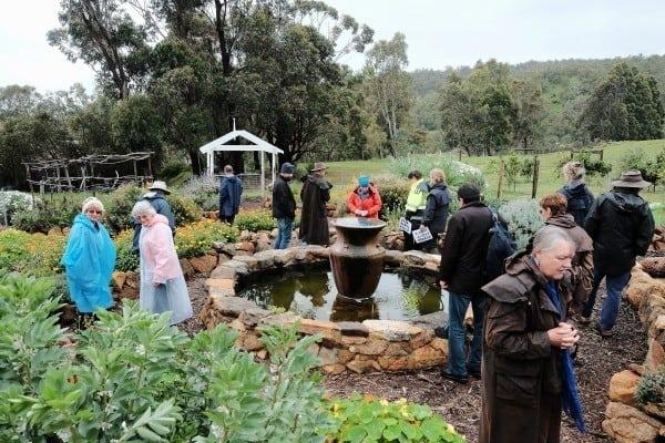people looking aroung garden