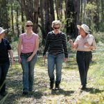 four women walking through a paddock in Jarrahdale for the Healthy Habitats program