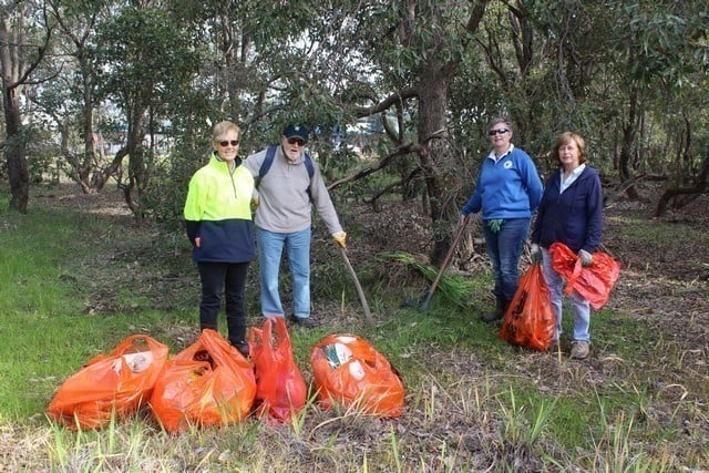 members of Byford Envirolink standing behind bags of rubbish collected in Byford, Western Australia