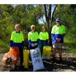 four members of Byford Enviro-link with bags of rubbish and plants guards at Mundijong Road