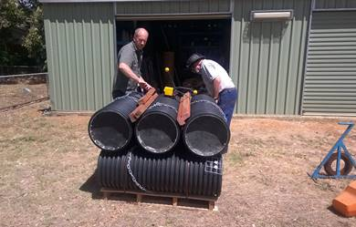 two men preparing artificial nest boxes for shipment to Victoria