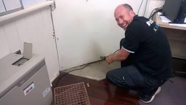 a man rescuing a possum