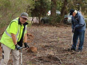 2 men planting seedlings